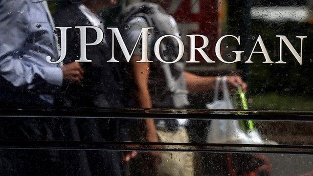 People walk by JP Morgan Chase Company headquarters in New York