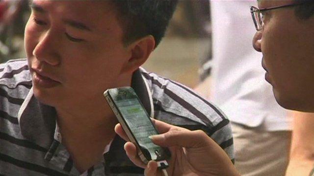 Vietnamese men using internet on mobile phones