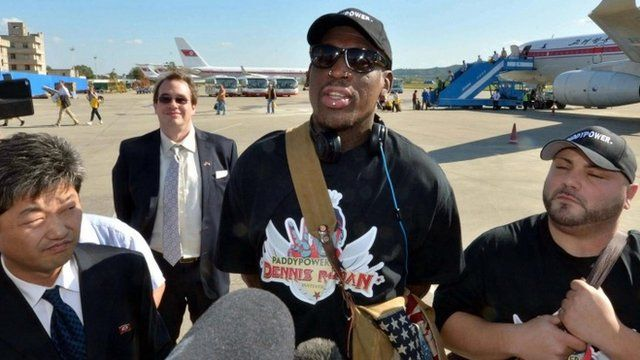 Former basketball star Dennis Rodman (C) arrives at Pyongyang airport, in this photo taken by Kyodo September 3, 2013