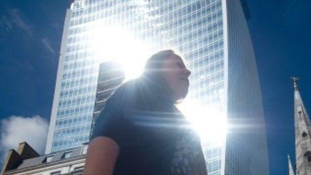 "Woman walks through shaft of light from ""Walkie Talkie"" skyscraper"