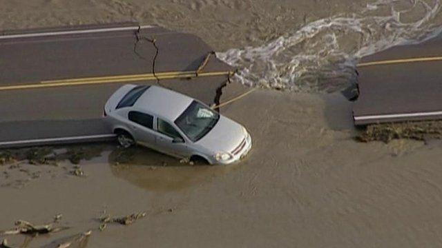 Car stuck in Colorado flooding
