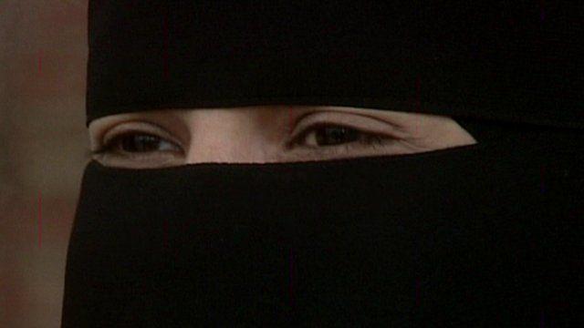 A woman's eyes through a niqab (face-veil)