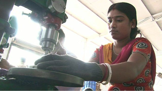 A factory worker in India