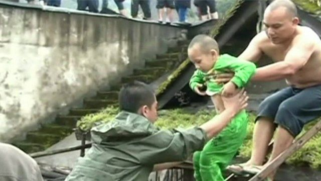 Small boy being lifted to safety