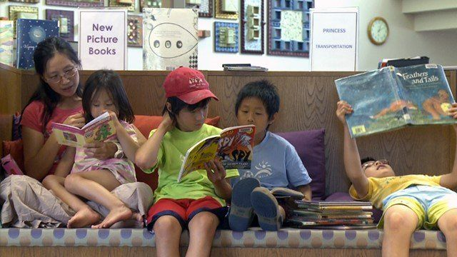 Asian American family at the library