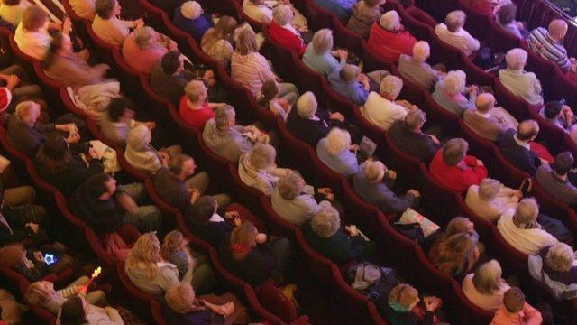 Audience watching a play