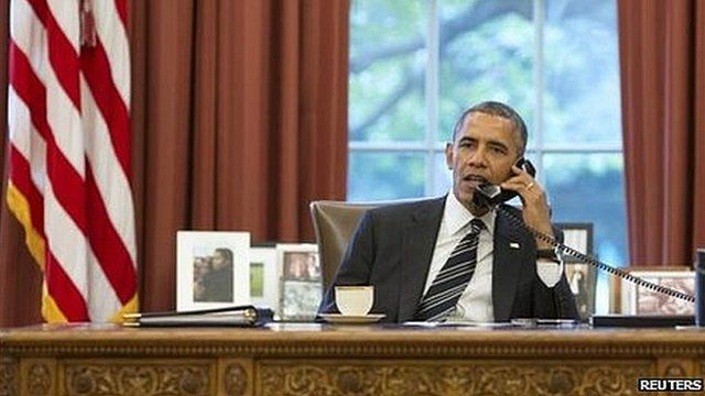 US President Barack Obama speaking by phone to President Hassan Rouhani of Iran (27 September)
