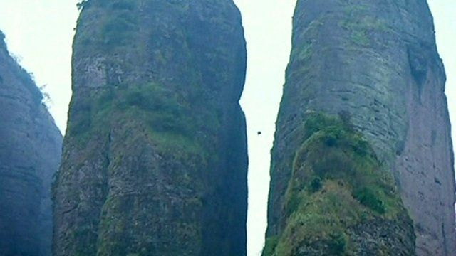 Wingsuit dive through narrow crevasse