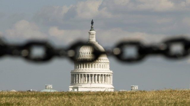 US Capitol behind a chain fence