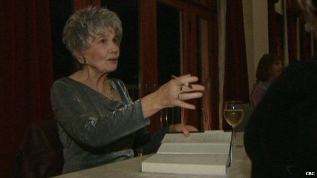 Alice Munro signing books