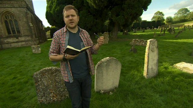 Poet Mark Grist reading his poem in a graveyard