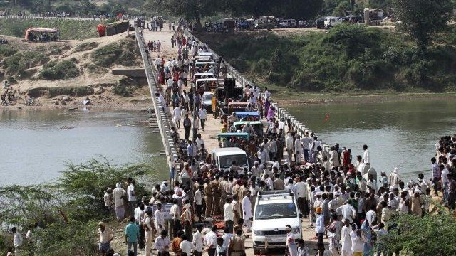 People cross a bridge after the stampede