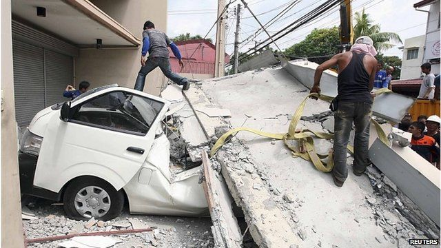 Car trapped under ruins of building