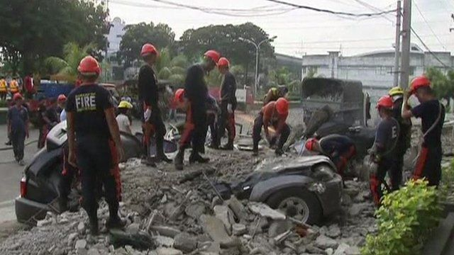 Relief workers clearing earthquake rubble