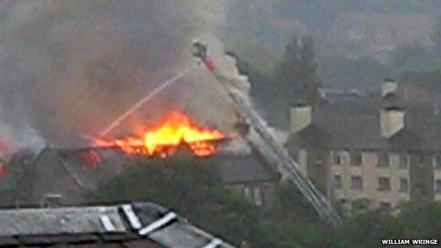 Firefighter attends to a fire in Edinburgh