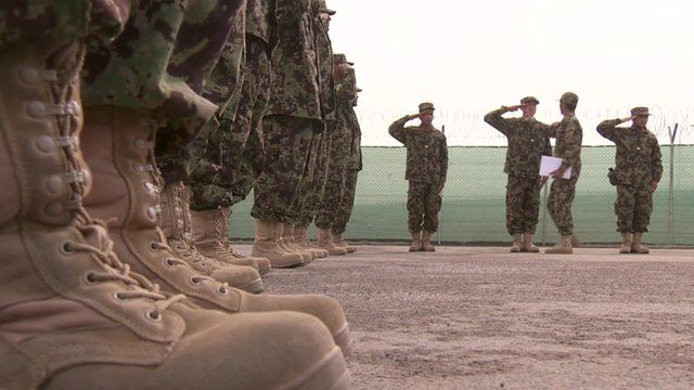 Close-up of army boots as soldiers are inspected