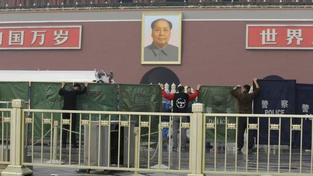 Barriers are set up in Tiananmen Square after the crash