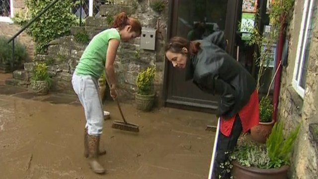 Clearing out muddy flood water