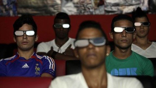People watch a 3D movie