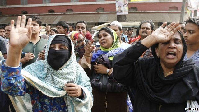 Relatives of soldiers react to the court's ruling in Dhaka
