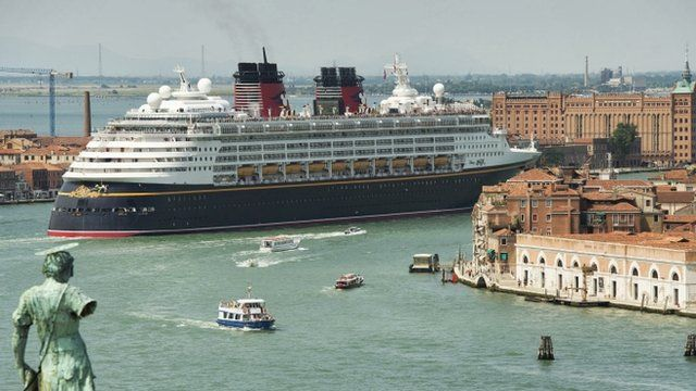 Cruise liner dwarfing Venice's buildings