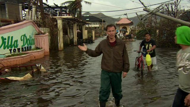BBC correspondent Rupert Wingfield-Hayes in flooded Tacloban