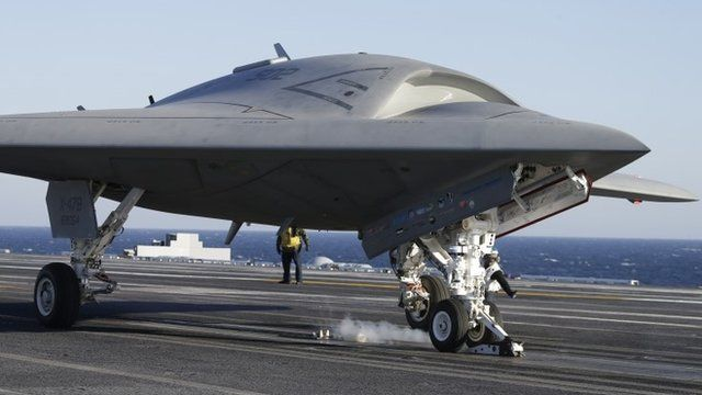 The Navy experimental unmanned aircraft, the X-47B, is launched off the deck of the nuclear powered aircraft carrier USS Theodore Roosevelt off the Virginia coast, Sunday, Nov. 10, 2013