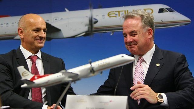 Etihad president James Hogan (R) & Maurizio Merlo of Darwin Airlines shake hands after sealing a deal