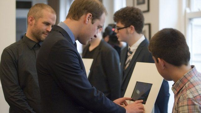 Prince William tries a computer game