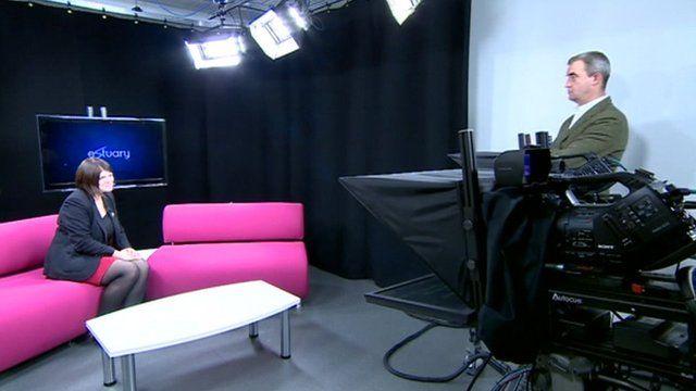 Emma Lingard and Giles Dilnot on TV set