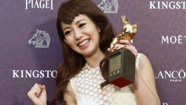 Taiwanese actress and singer Kuo Shu-yau holds Golden Horse award