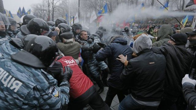 Protesters and riot police clash