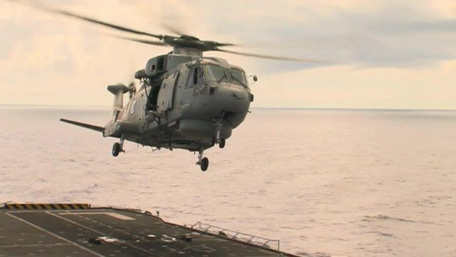 Helicopter leaving HMS Illustrious