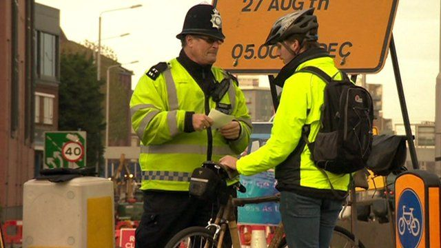 Police officer with cyclists