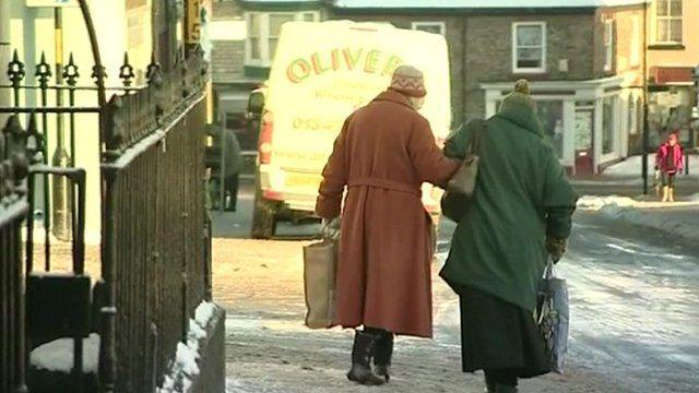 Elderly ladies walk in the snow