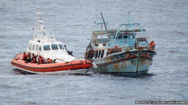 Coastguard rescues migrants off boat near Italy