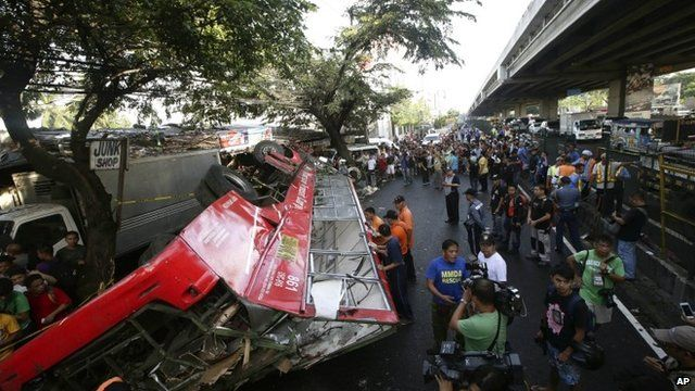 Crashed bus and crowd of people