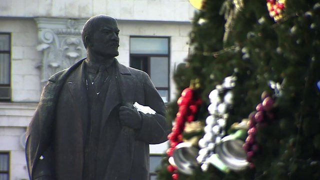 Statue of Lenin and Christmas tree