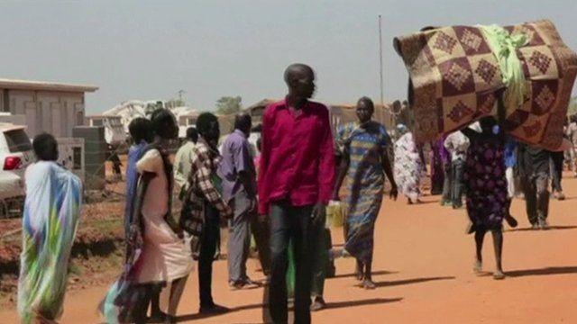 People walking in the street with their belongings