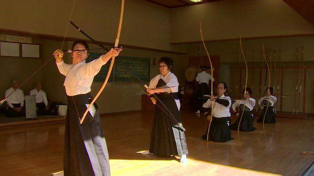 People practise archery