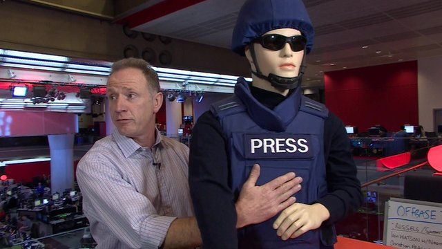 Simon Marr and mannequin wearing body armour