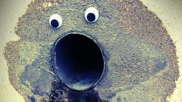 Goggly eyes stuck on a pipe