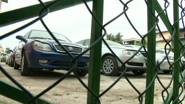 Cars behind wire fence