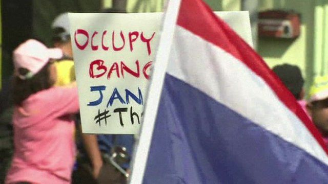 Placard and flag at anti-government protest in Bangkok