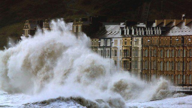 Waves crash against the Aberystwyth coastline