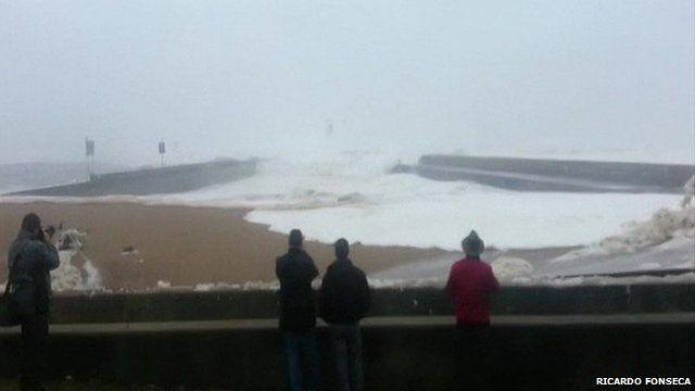 Portugal storm 'surge' wave destroys cars