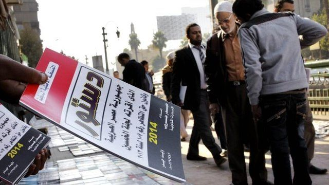 An Egyptian vender sells copies of the last constitution in Cairo, Egypt, 28 December 2013