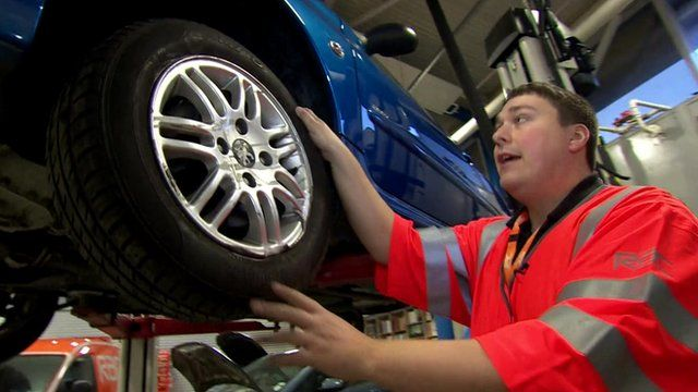 RAC technician Matt Woodbridge with damaged car
