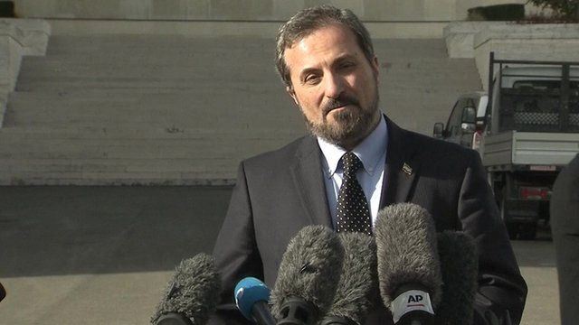 Syria opposition, SNC, spokesman Louay Safi at news conference in Geneva
