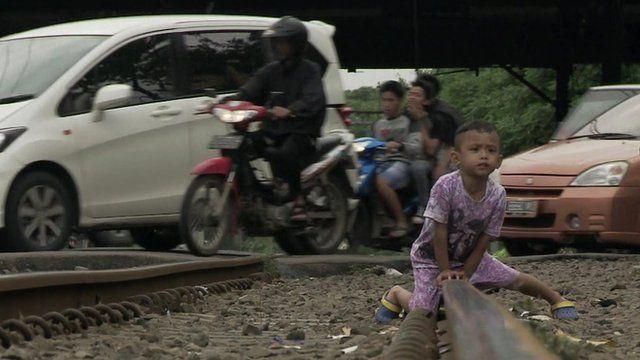 boy playing on train tracks